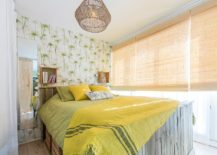 Rattan-window-blinds-and-wallpaper-with-green-leafy-pattern-for-the-tropical-bedroom-217x155