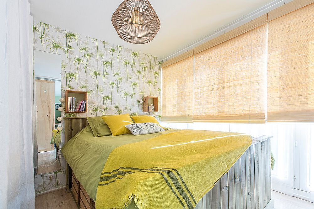 Rattan window blinds and wallpaper with green leafy pattern for the tropical bedroom