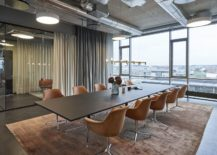 Raw-industrial-elements-combined-with-modern-finishes-inside-the-office-217x155