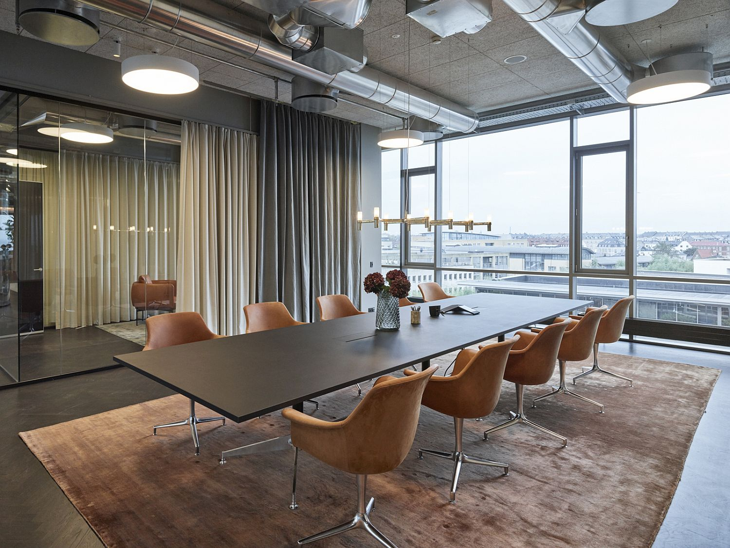 Raw industrial elements combined with modern finishes inside the office