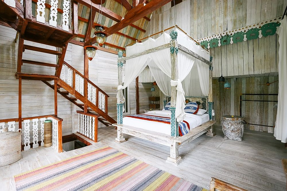 Reclaimed wood and soft white fabrics create a beautiful and timeless tropical bedroom
