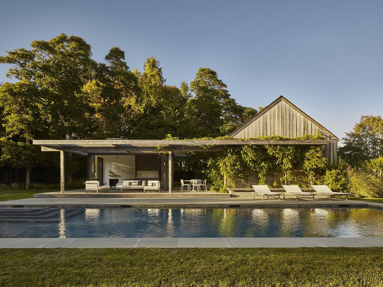 Relaxing modern pool house next to contemporary pool