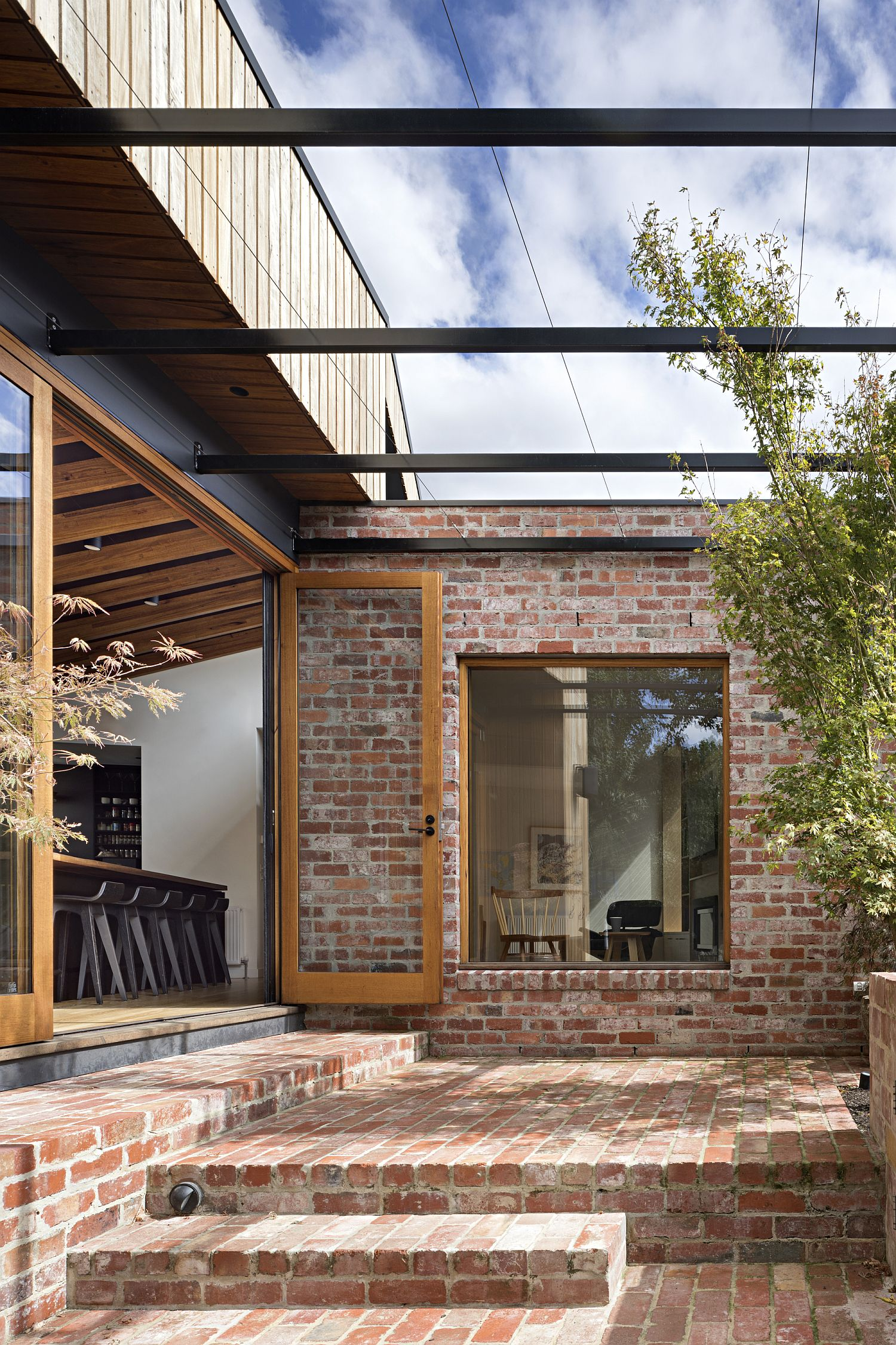 Restored and altered Victorian home with brick and timber exterior
