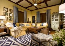 Rustic-and-cozy-living-room-in-yellow-with-gorgeous-layered-blue-decor-217x155