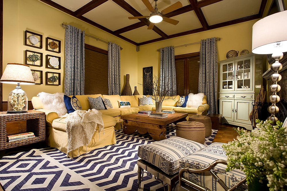 Rustic and cozy living room in yellow with gorgeous layered blue decor