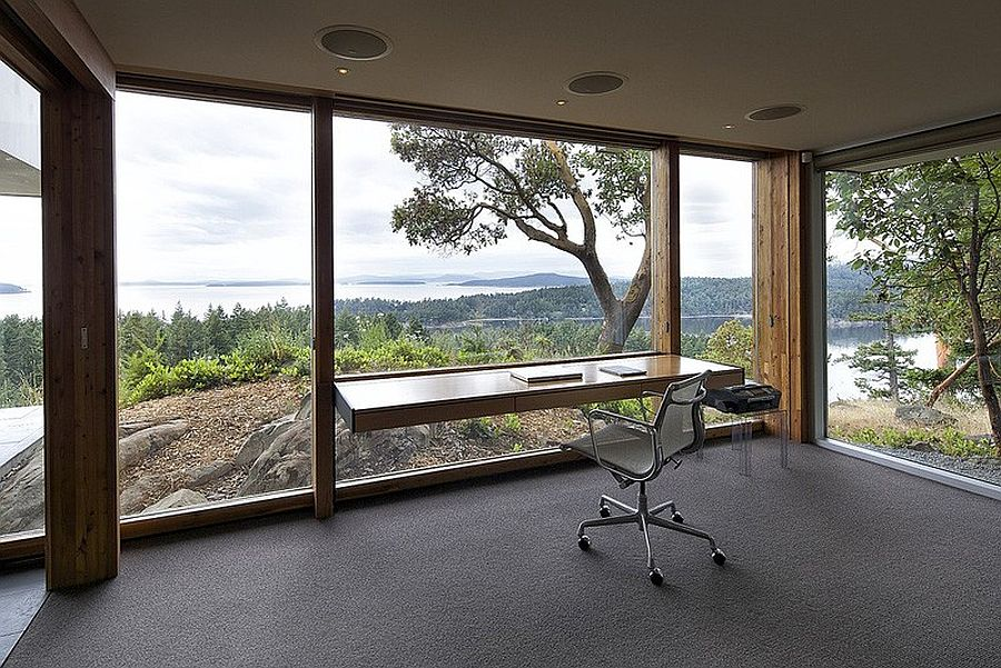 Slim desk and glass walls put the focus on view outside