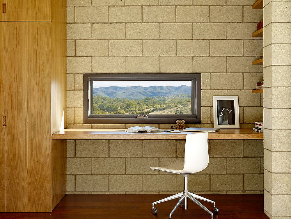 Small window above the workstation brings the outdoors into the home office