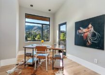Small-window-and-a-spacious-balcony-bring-mountain-views-into-this-modern-home-office-in-gray-217x155