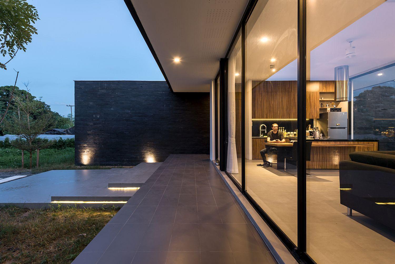 Smart LED lighting illuminates the entrance and the landscape outside