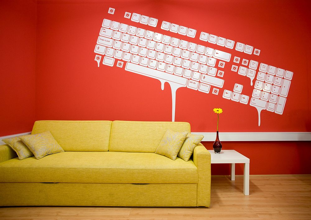 Smart red backdrop in the room complements the yellow couch in a refined manner