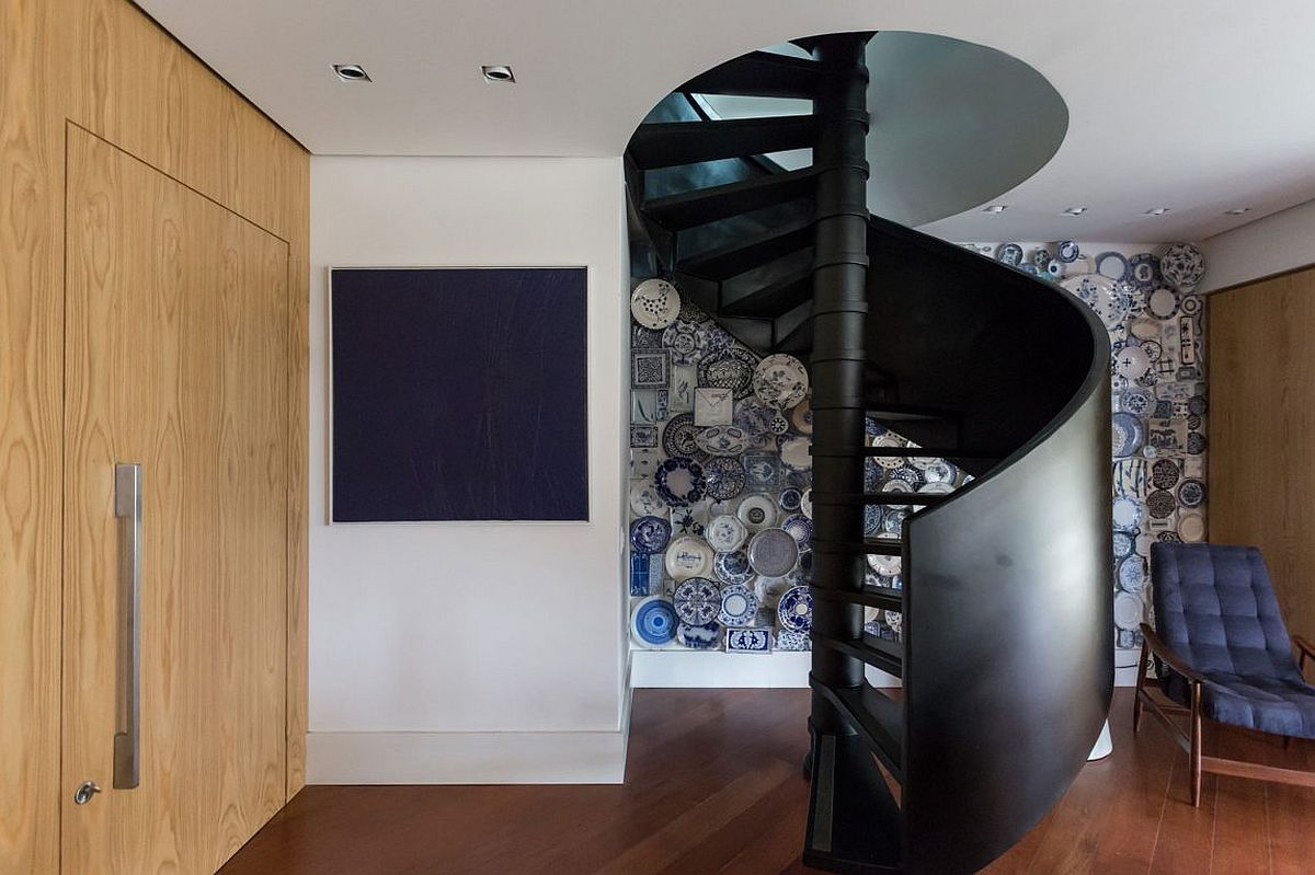 Space-saving spiral staircase with unique accent wall in the backdrop