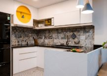 Space-savvy-and-stylish-kitchen-with-white-cabinets-and-tiled-backsplash-217x155
