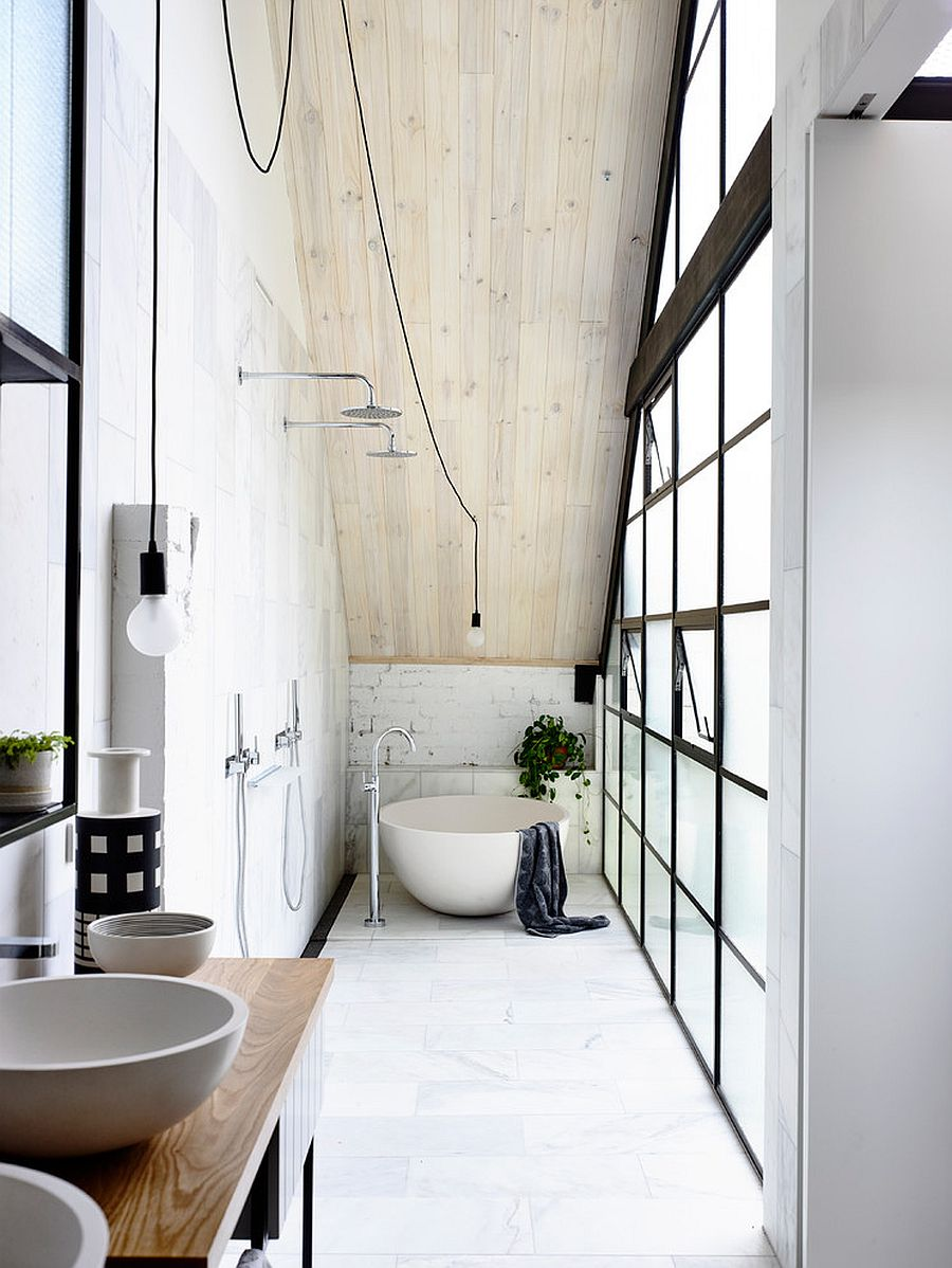 Space-savvy industrial bathroom with plenty of natural lighting