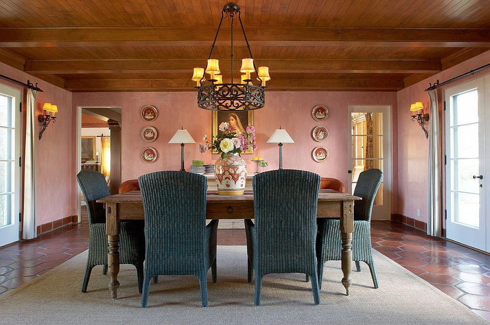 Spacious dining room with wooden ceiling and plush pink walls
