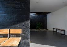 Stone-wall-becomes-an-intergral-part-of-the-contemporary-interior-217x155