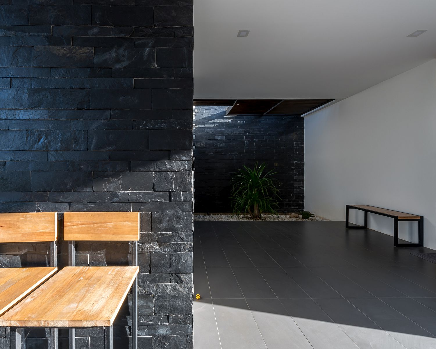 Stone wall becomes an intergral part of the contemporary interior