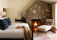 Stone-wall-with-fireplace-is-a-classic-in-the-bedroom-that-never-dissapoints-217x155