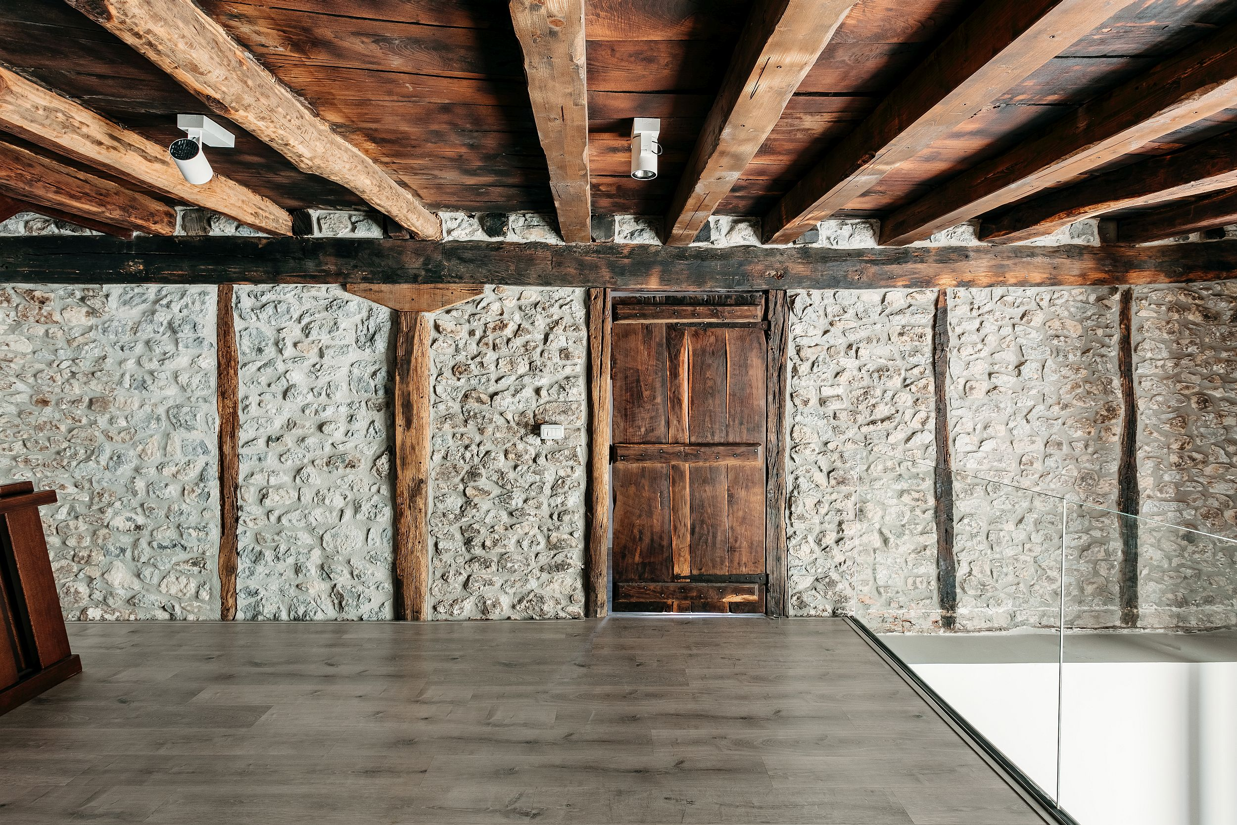 Stone walls and wooden ceiling of the home