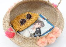Storage-basket-with-bright-pom-poms-217x155