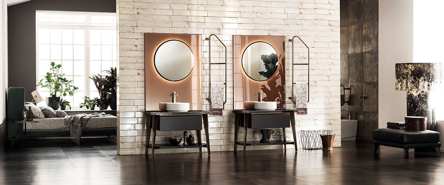 Stunning use of mirrors, lighting and vaniy in the modern industrial bathroom
