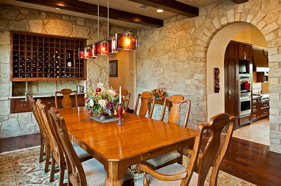 Stylish and well-lit Mediterranean dining room with stone walls
