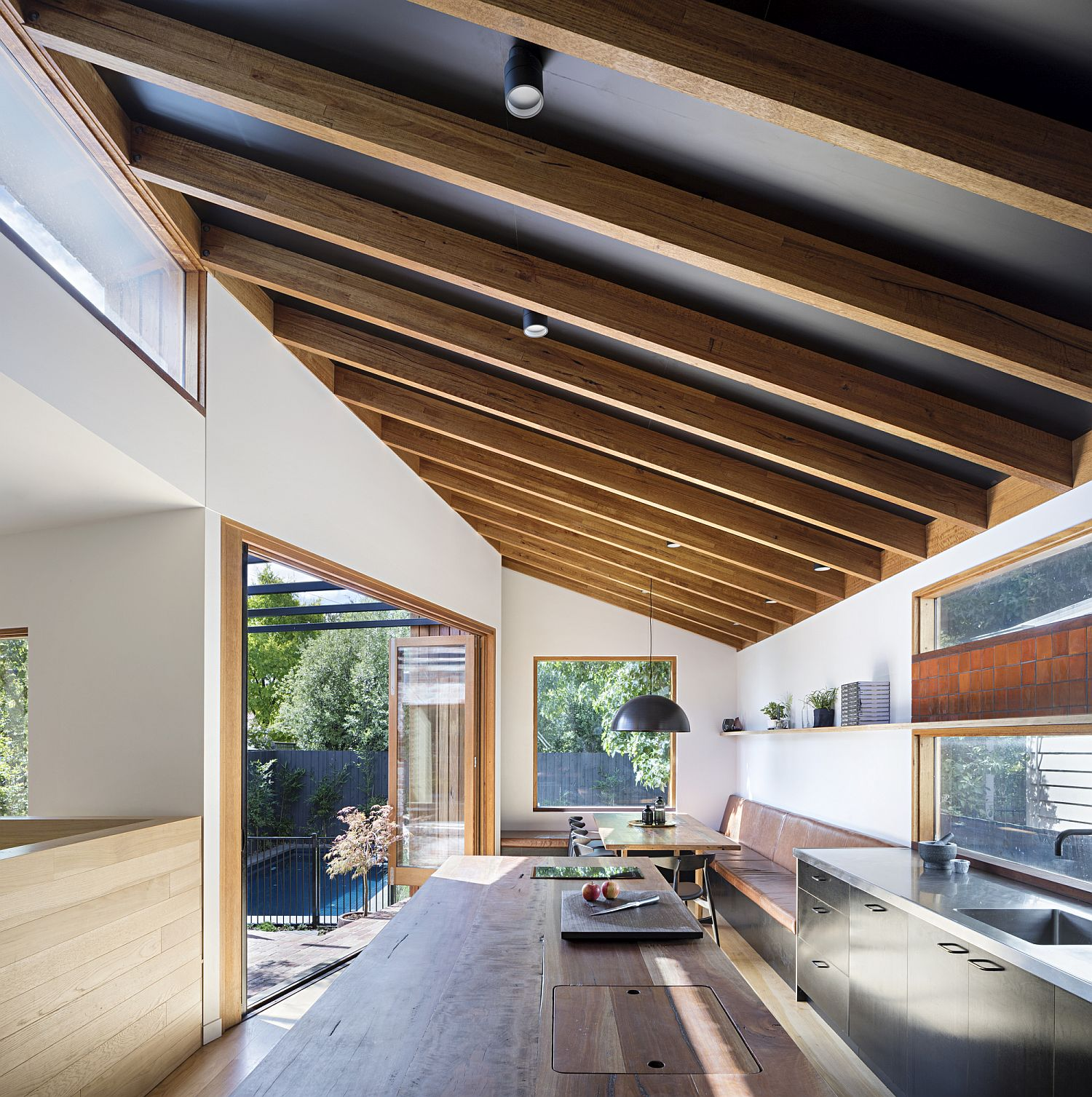 Timber ceiling beams give the interior a modern classic look