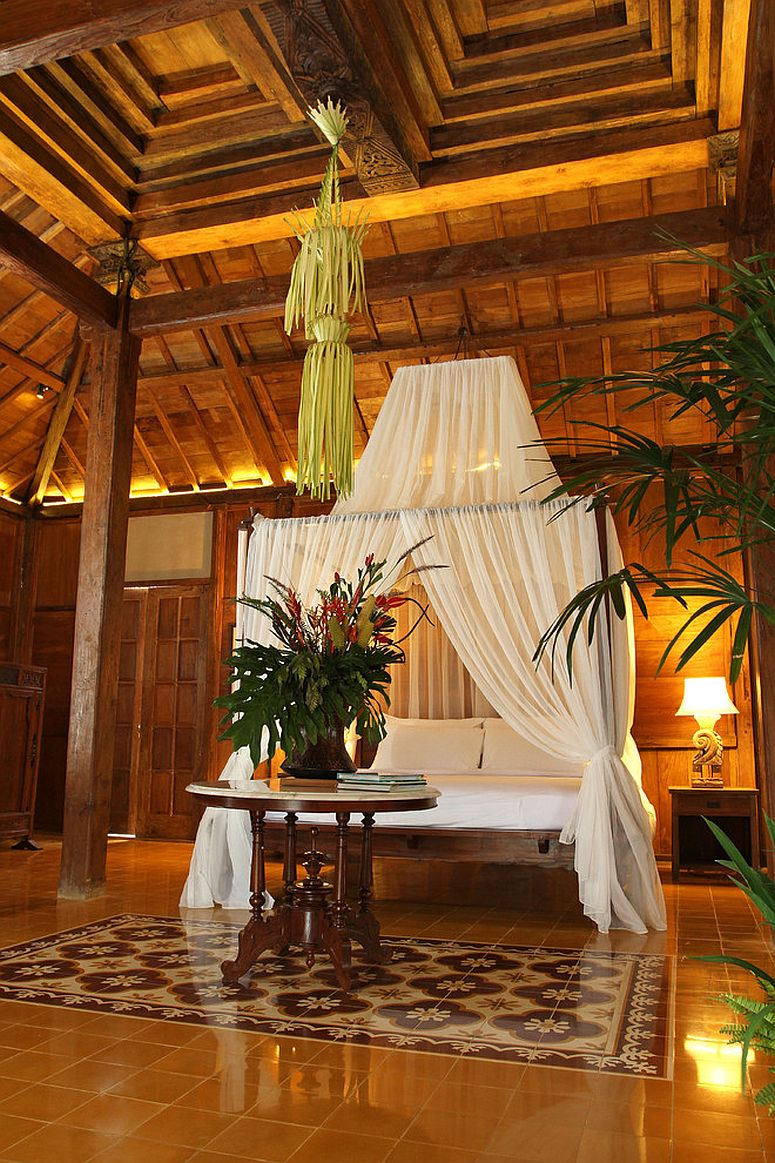 Tropical holiday inspired bedroom with luxurious canopy bed