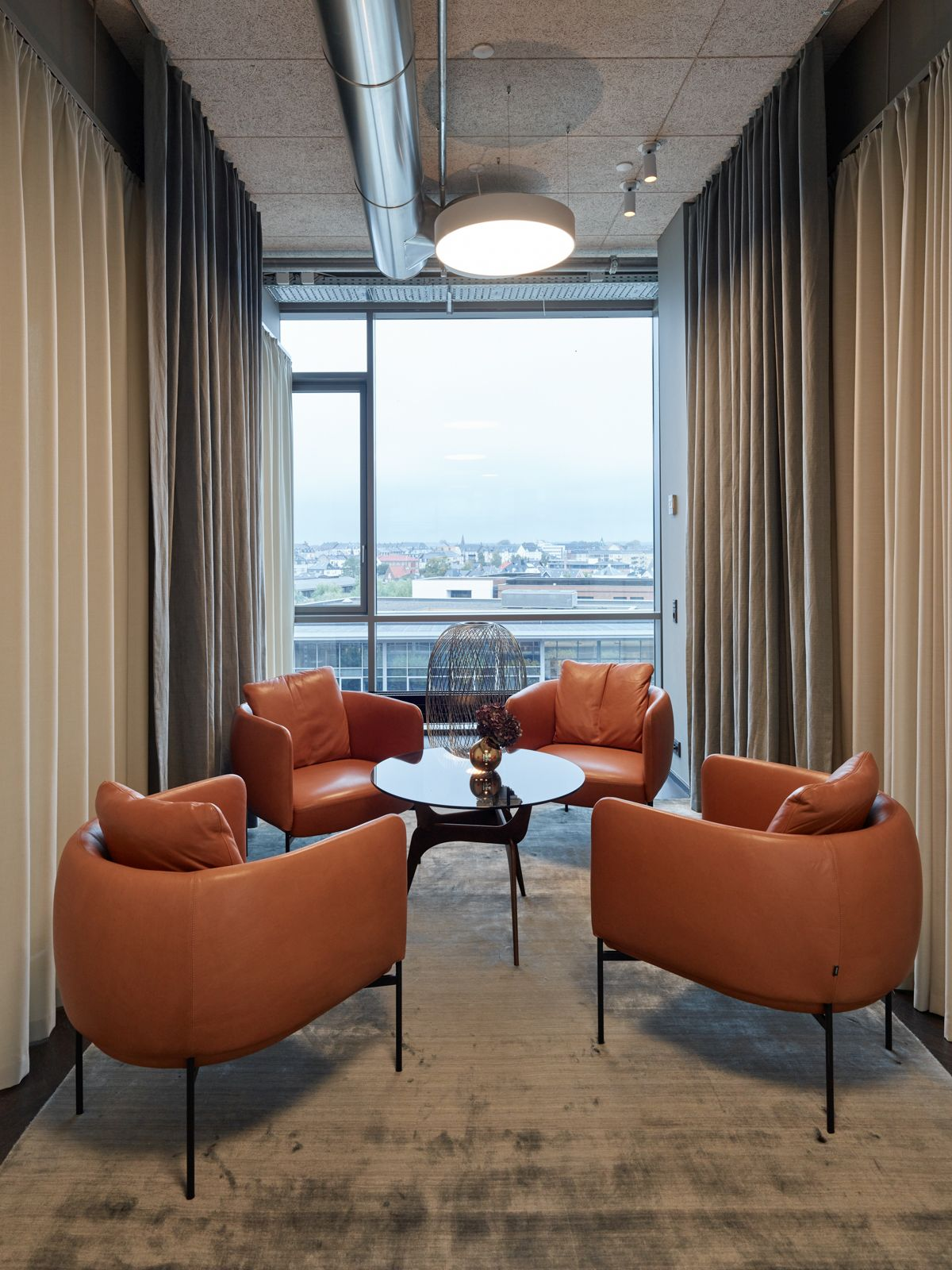 Turn the open office into a private meeting room using drapes