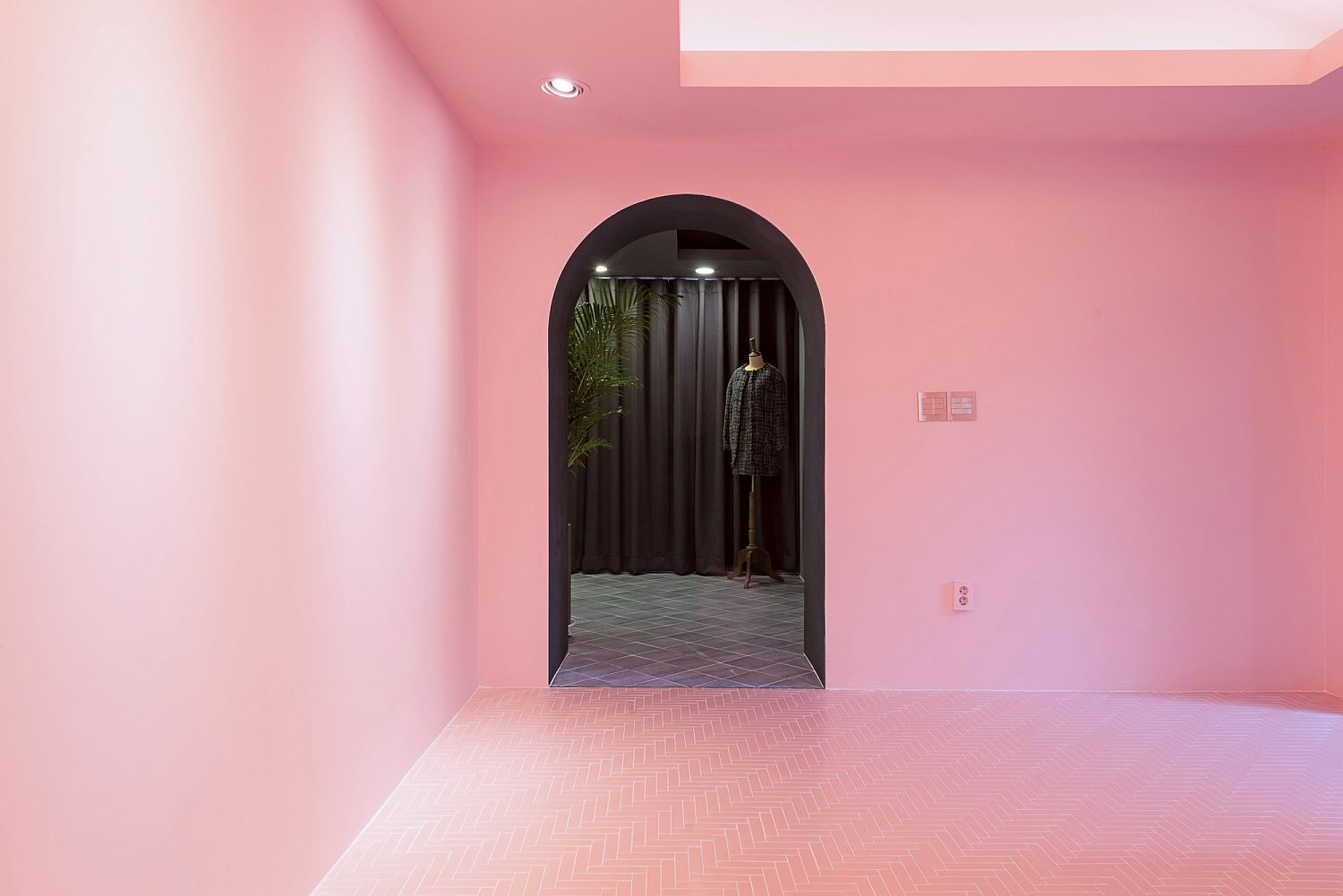 View of the gray office room from the pink entry