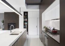 White-and-wood-kitchen-with-double-height-ceiling-217x155