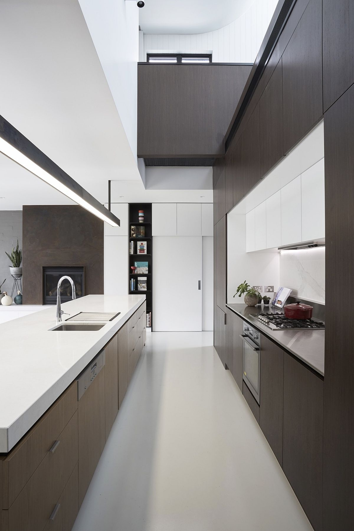 White and wood kitchen with double height ceiling