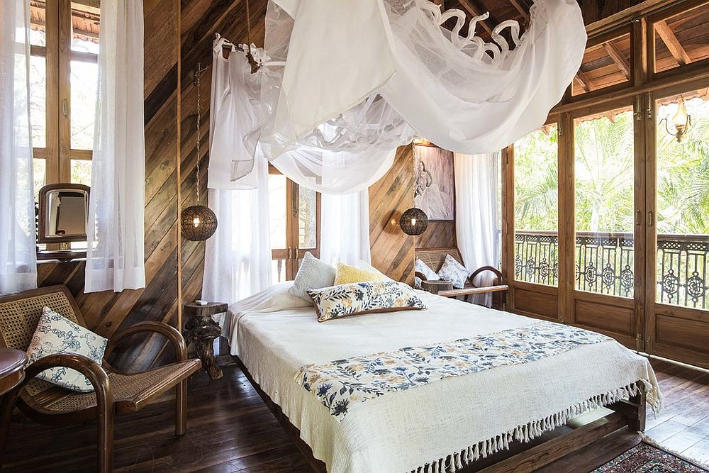 Wood and white tropical style bedroom with a beautiful balcony