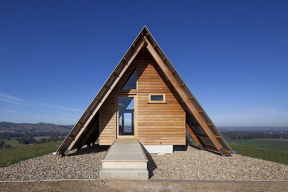 Wooden extreior and A-frame form of the JR's Hut