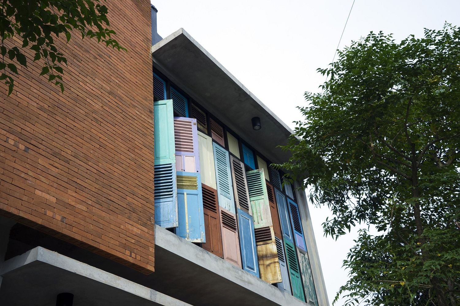 Wooden panels and reclaimed shutters give the building a unique facade