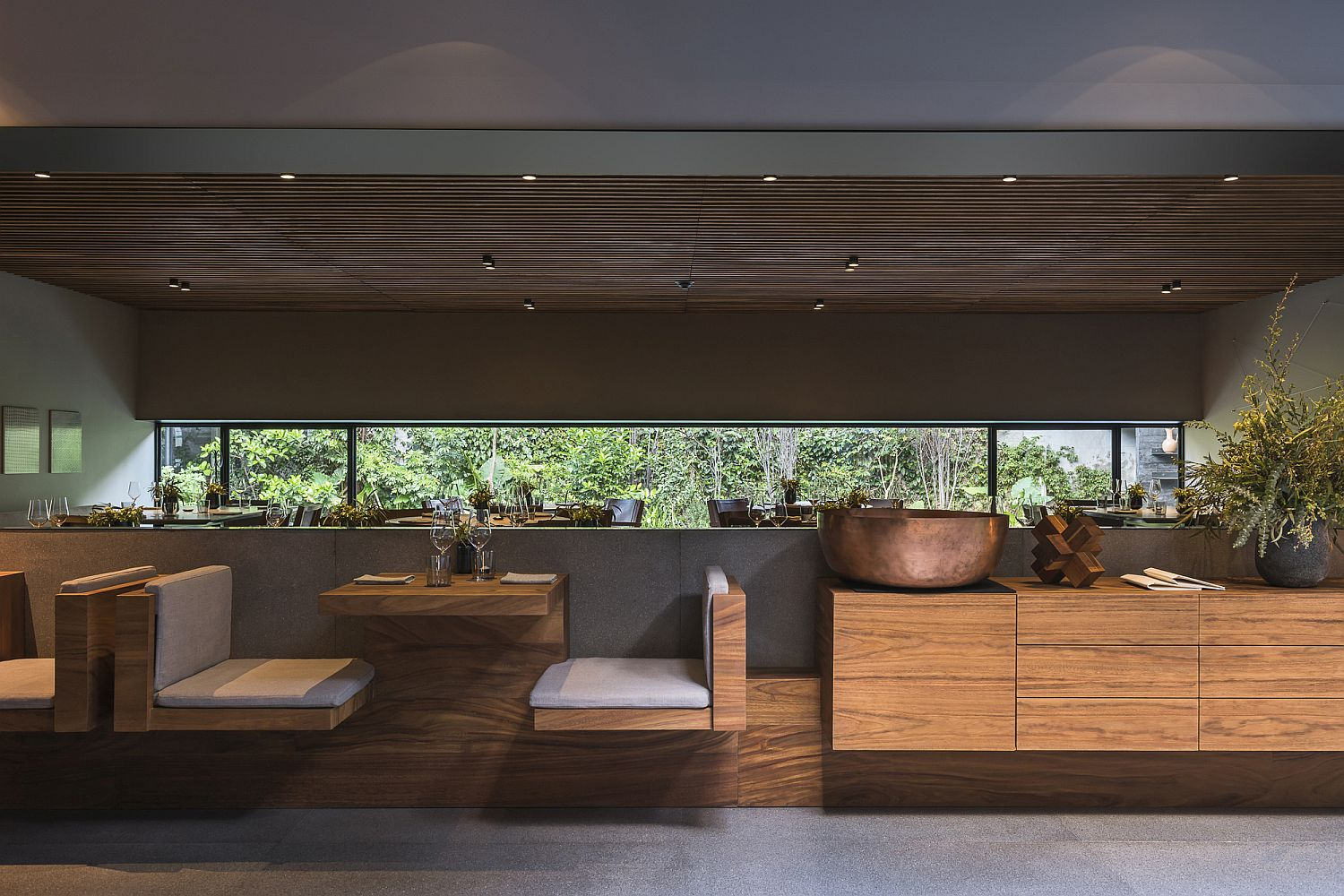 Wooden-seating-along-with-the-new-ceiling-creates-an-intimate-setting