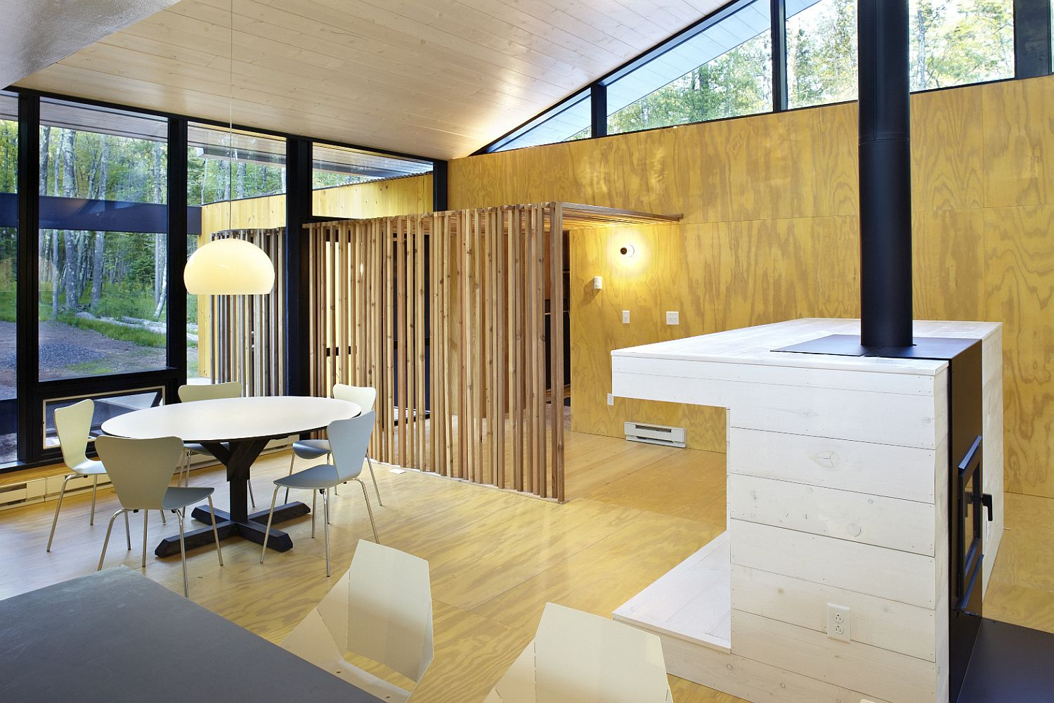 Wooden-slats-help-delineate-space-inside-the-home-without-obstructing-light