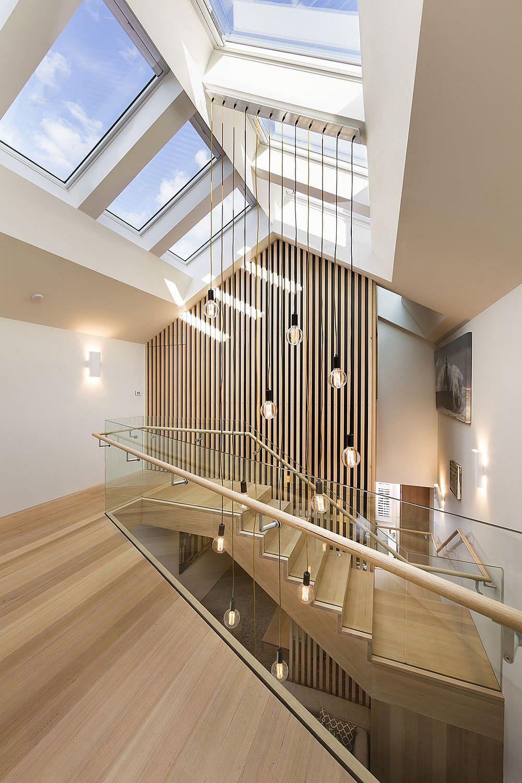Wooden-stairway-illuminated-using-Edison-bulb-lights