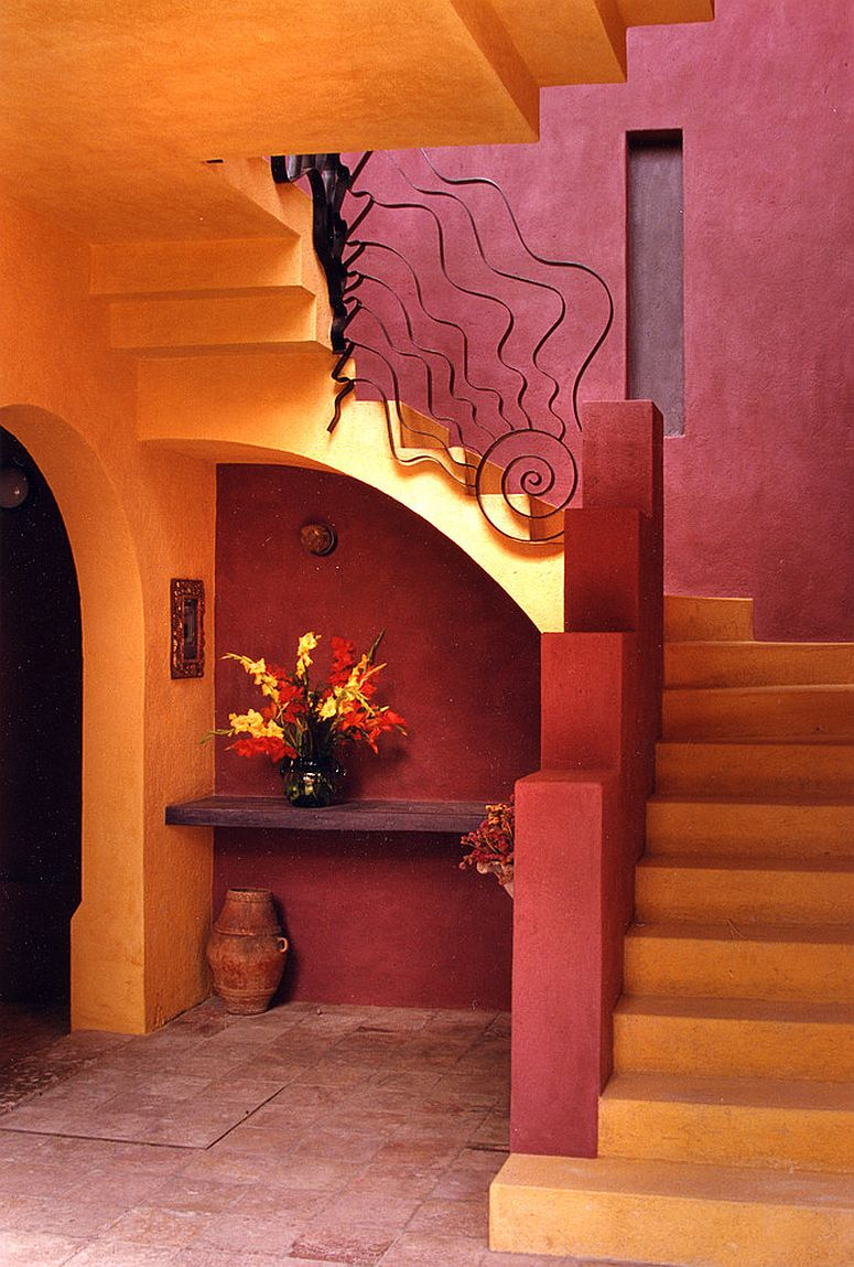 Yellow and red combine to create a stunningly dramatic entryway and staircase