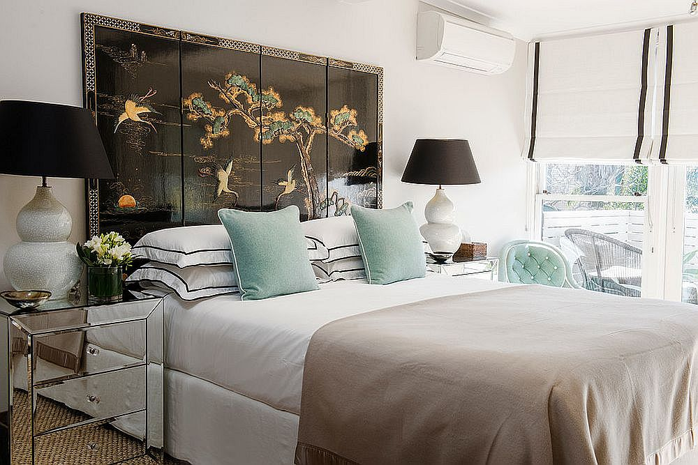 A touch of pastel green brings freshness to the white bedroom