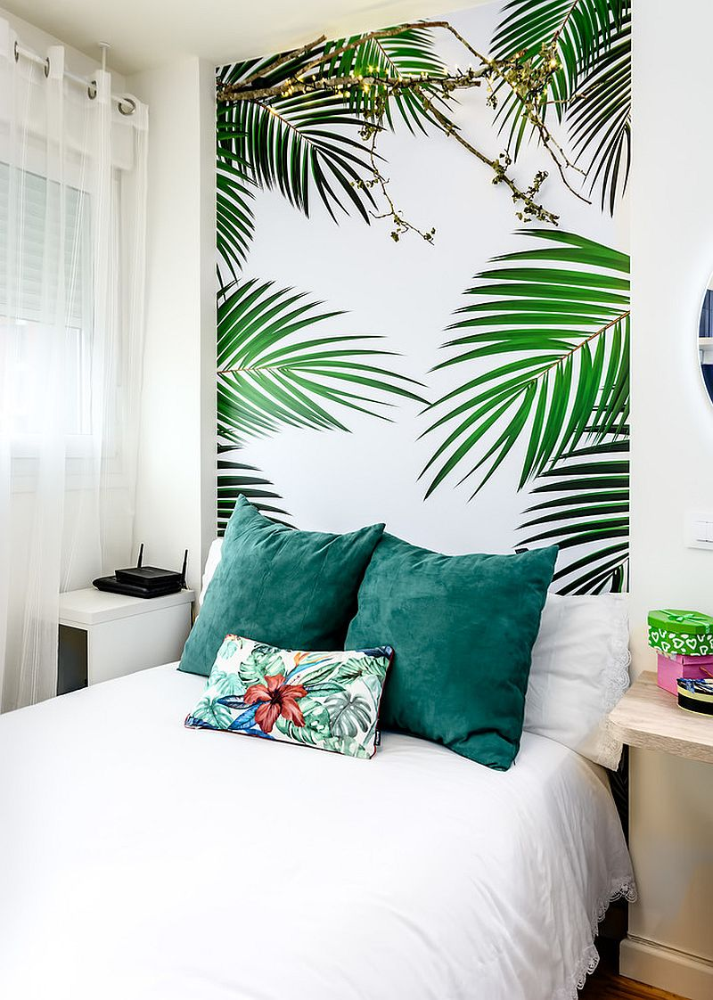 All white bedroom with a tropical wallpaper headboard from habitaka diseño y decoración