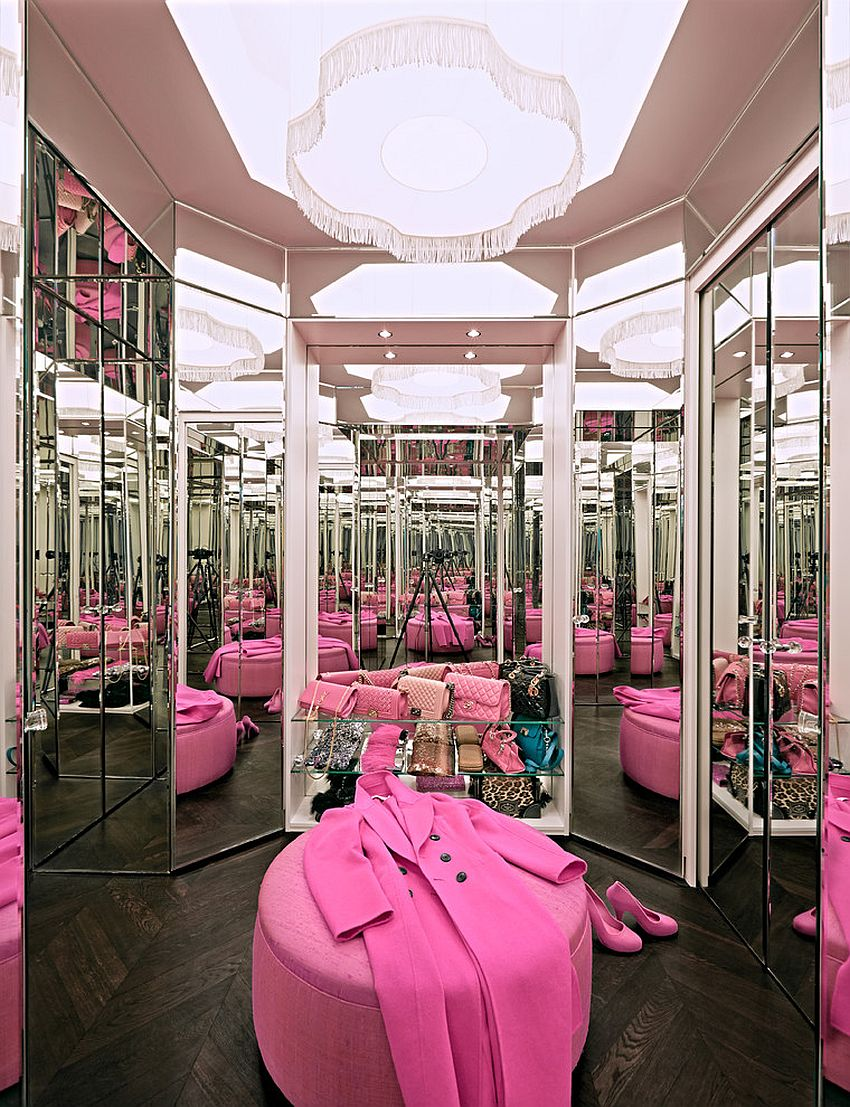 Amazing-eclectic-closet-with-mirrored-shelves-doors-and-walls-and-a-dash-of-pink