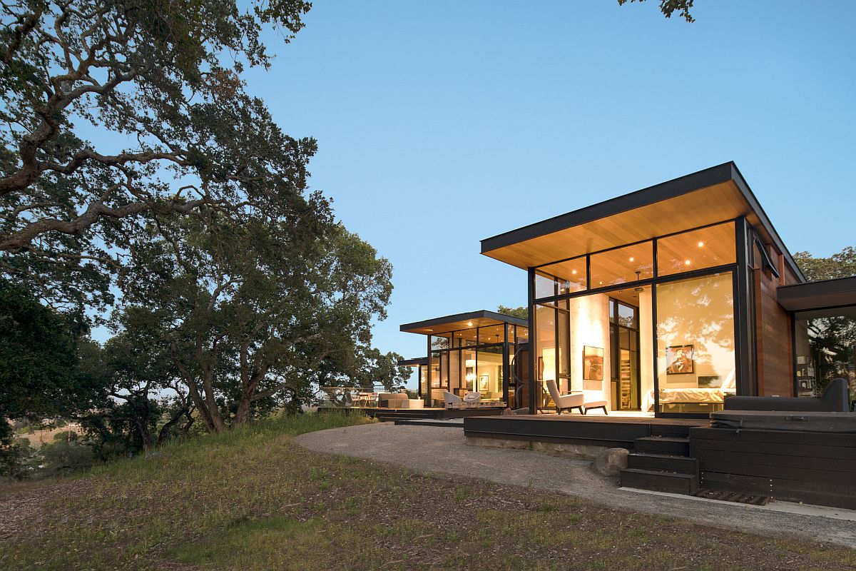 An elevated platform creates the perfect base for a home surrounded by Oak trees and woods