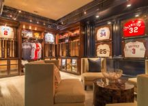 Baseball-bats-neatly-lined-up-on-the-wall-add-to-the-appeal-of-the-sports-themed-home-theater-217x155