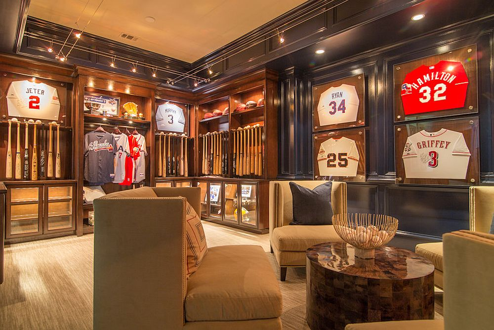 Baseball bats neatly lined up on the wall add to the appeal of the sports-themed home theater