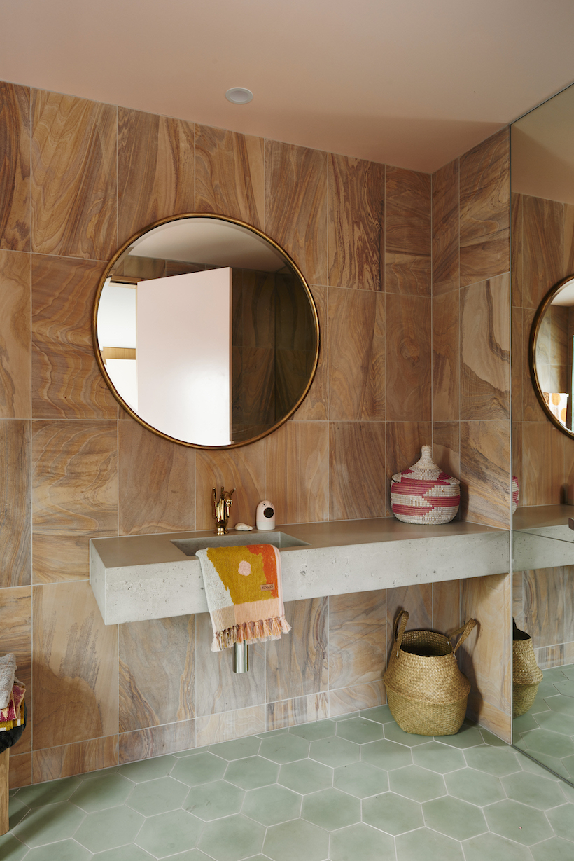 Baskets add function and style to a powder room