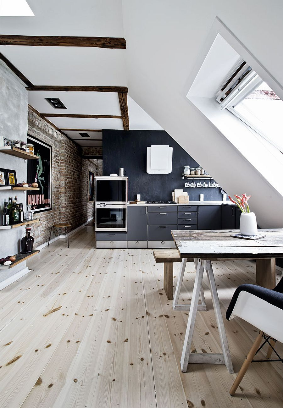 Beautiful attic apartment kitchen combines wood, brick and a dash of black!
