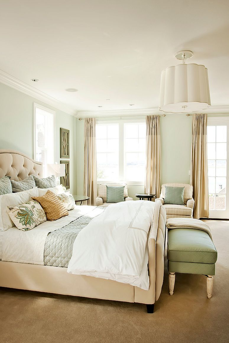 Beautiful traditional bedroom in white, beige and pastel green
