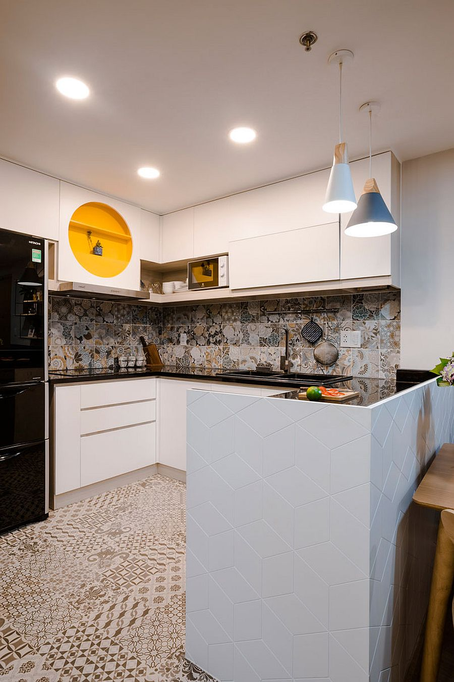 Bright tiles and pops of yellow and blue for the small kitchen in white