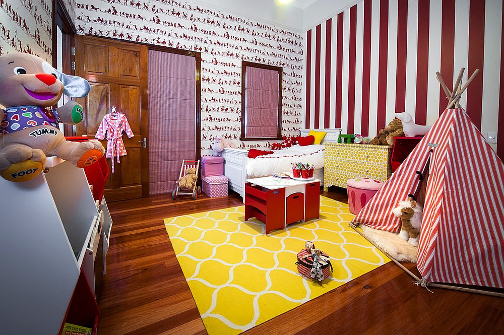 Charming kids' room with plenty of pattern and a rug that brings in yellow