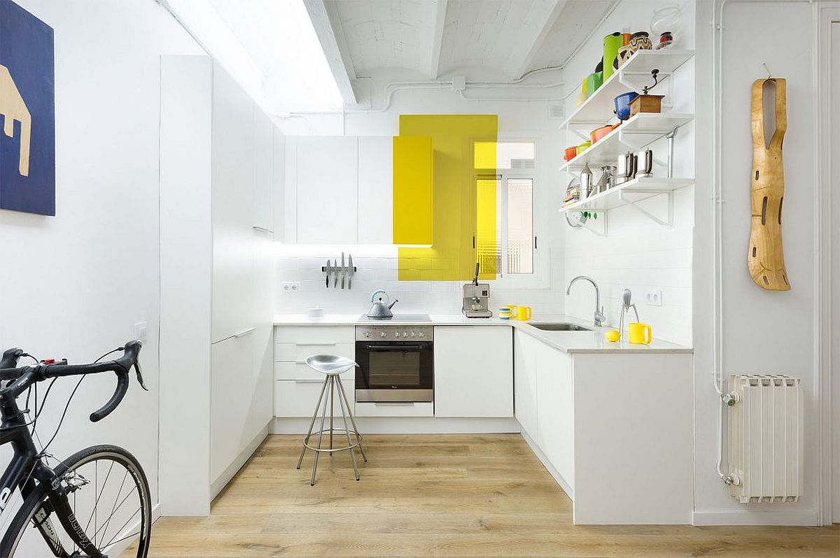 Color blocking steals the show inside this tiny apartment kitchen in white